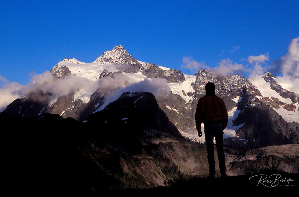 Evening light on Mount Shuksan (silhouetted hiker in foreground), North Cascades National Park, Washington