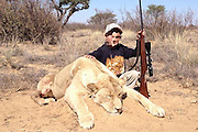 Sickening pictures show children as young as seven posing with lions they have slaughtered on African hunts<br /> <br /> These sickening pictures show two brothers aged seven and nine posing with a lion they slaughtered on a hunt.<br /> Big game hunter Allen Tarpley tweeted a photograph of his younger child with the animal - holding a rifle and wearing army camouflage, with the caption: 'My seven-year-old with his first lion.'<br /> Another similar image posted by Indiana-based Mr Tarpley showed the boy's nine-year-old brother also holding a gun next to a lion. Both photos are believed to have been taken on an African safari.<br /> <br /> Anti-hunting campaigners described the images as 'sickening' last night, while Mr Tarpley's Twitter account - @Safarihunter77 - was swamped with angry messages and has since been taken down.<br /> ©Exclusivepix Media