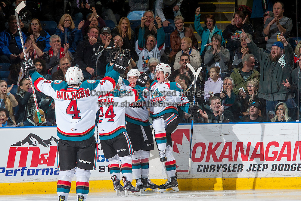 KELOWNA, CANADA - MARCH 4: Gordie Ballhorn #4, Kyle Topping #24, Rodney Southam #17 and Nolan Foote #29 of the Kelowna Rockets celebrate a goal against the Tri-City Americans on March 4, 2017 at Prospera Place in Kelowna, British Columbia, Canada.  (Photo by Marissa Baecker/Shoot the Breeze)  *** Local Caption ***