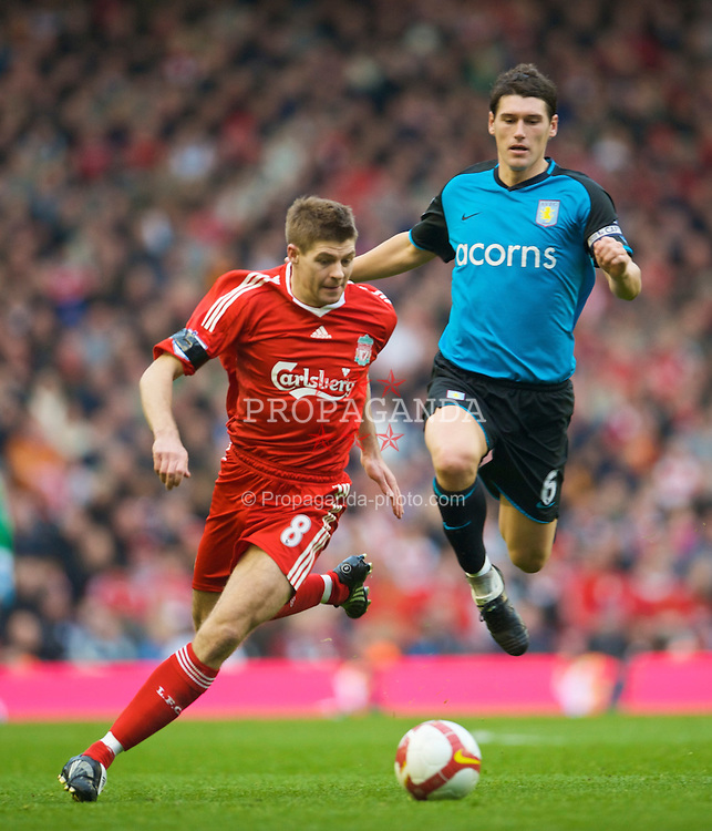 LIVERPOOL, ENGLAND - Sunday, March 22, 2009: Liverpool's captain Steven Gerrard MBE and Aston Villa's Gareth Barry during the Premiership match at Anfield. (Photo by David Rawcliffe/Propaganda)
