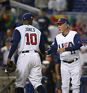 March 12, 2017 - Miami, FL, USA - United States manager Jim Leyland celebrates with center fielder Adam Jones (10)  after defeating Canada 8-0 in a World Baseball Classic first round Pool C game on Sunday, March 12, 2017 at Marlins Park in Miami, Fla. (Credit Image: © David Santiago/TNS via ZUMA Wire)
