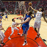 27 February 2018: San Diego State men's basketball hosts Boise State in their last meet up of the regular season at Viejas Arena. San Diego State Aztecs forward Jalen McDaniels (5) battles Boise State Broncos center Robin Jorch (10) for a rebound in the first half. The Aztecs beat the Broncos 72-64.  <br /> More game action at sdsuaztecphotos.com