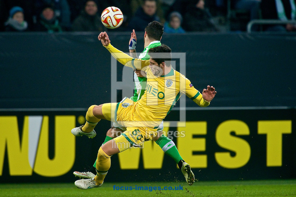 Vierinha of VfL Wolfsburg (top) and  of Sporting Clube de Portugal during the UEFA Europa League match at Volkswagen Arena, Wolfsburg<br /> Picture by Ian Wadkins/Focus Images Ltd +44 7877 568959<br /> 19/02/2015