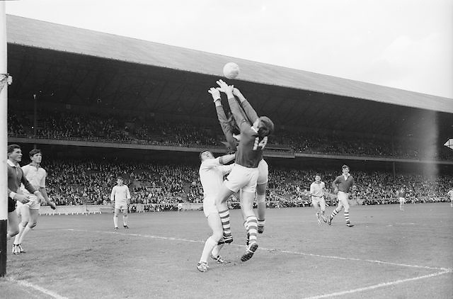 Cork's M. Doherty grabs at the ball as he is tackled by Sligo's full back during the All Ireland Minor Gaelic Football Final Sligo v. Cork in Croke Park on the 22nd September 1968.