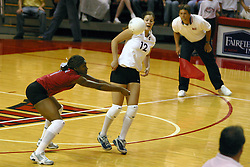 Stanford University's Ogonna Nnamani sets the ball from the back row while team mate Jennifer Hucke retreats out of the way.  ISU Vs. Stanford at ISU's REdbird Arena, Normal Illinois, Setember 11, 2002<br />