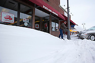 Bob Larson shovels the snow from the sidewalk in front of his office in Grinnell, Iowa on Wednesday February 2, 2011.