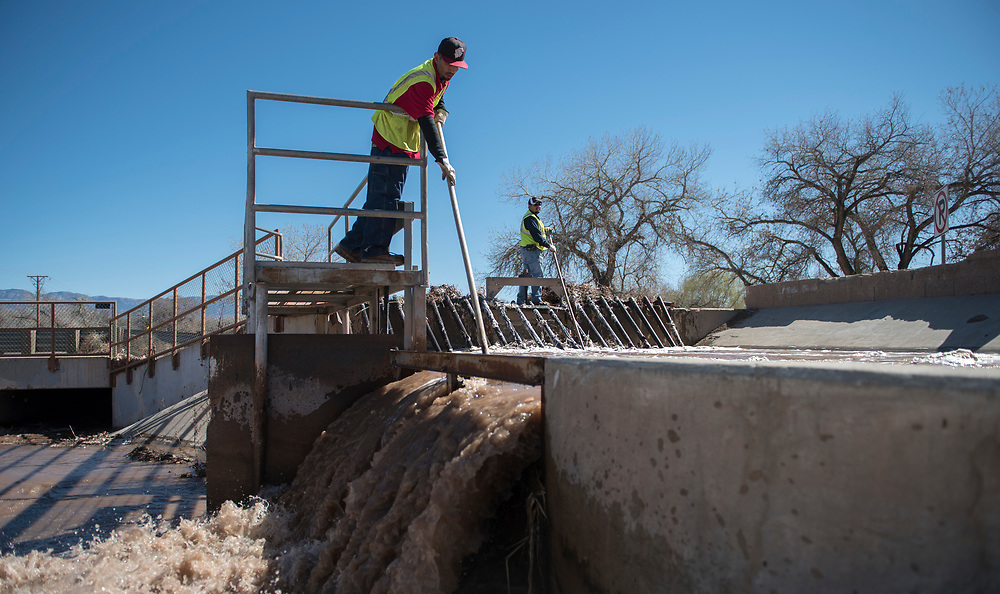 rer030217b/a1/03.02. 2017/Roberto E. Rosales<br /> Fernando  G. (Cq),left and Johnny Apodaca(cq), both of the Middle Rio Grande Conservancy District,  continue to clear debris from the main canal in Corrales after opening the gates for water to flow into the area. <br /> Roberto E. Rosales/Albuquerque Journal<br /> Corals, New Mexico