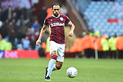 Aston Villa defender Ahmed Elmohamady (27) sprints forward with the ball during the EFL Sky Bet Championship match between Aston Villa and Middlesbrough at Villa Park, Birmingham, England on 16 March 2019.
