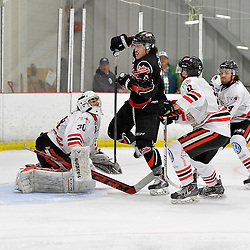 """FORT FRANCES, ON - May 2, 2015 : Central Canadian Junior """"A"""" Championship, game action between the Fort Frances Lakers and the Soo Thunderbirds, Championship game of the Dudley Hewitt Cup. Wyatt Cota #22 of the Fort Frances Lakers knocks the puck down over goaltender during the second period.<br /> (Photo by Shawn Muir / OJHL Images)"""