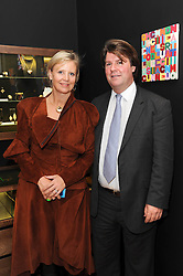 LOUISA GUINNESS and BEN BROWN at a pre lunch reception to celebrate the launch of the new Louisa Guinness gallery at Ben Brown Fine Art, Cork Street, London on 18th November 2009.