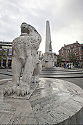 National Monument and Lion sculpture Dam Square in Amsterdam.