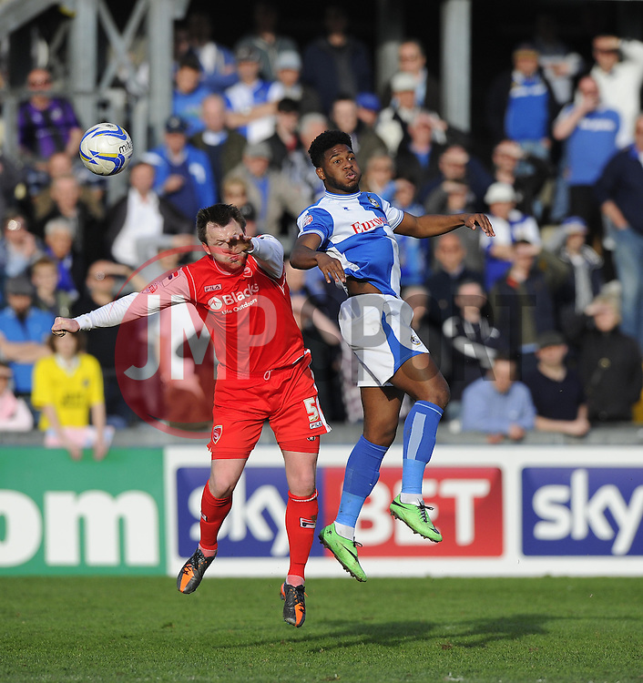 Bristol Rovers' Ellis Harrison battles for the high ball with Morecambe's Mark Hughes - Photo mandatory by-line: Joe Meredith/JMP - Mobile: 07966 386802 25/03/2014 - SPORT - FOOTBALL - Bristol - Ashton Gate - Bristol City v Port Vale - Sky Bet League One