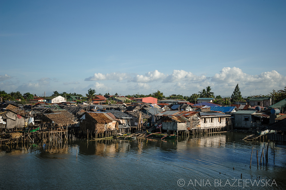 Philippines, Metro Manila. Squatters built in the water in Cavite.
