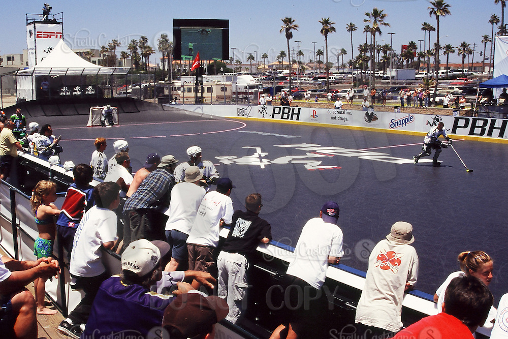 5 June 1999: Roller hockey player skating for a shootout in action during Pro Beach Hockey PBH game in Huntington Beach.   Southern California summer sport. Transparency slide scan.