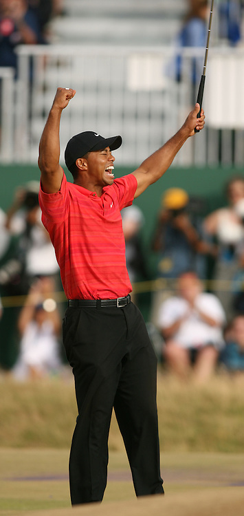 Tiger WOODS (USA) roars on the 18th green to celebrate winning for his 3rd Open during fourth round The Open Championship 2006,Royal Liverpool,Hoylake,Wirral,England.
