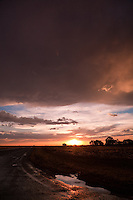 Storm passes over the landscape at sunset in southern NSW, Australia.
