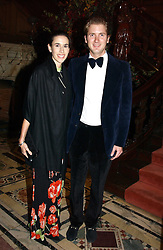 MR GEORGE LEWIS and MISS ELIZABETH MACAULAY at a recital and dinner to celebrate the 10th anniversary of The Galitzine Library held at 2 Temple Place, London WC2 on 16th November 2004.<br /><br />NON EXCLUSIVE - WORLD RIGHTS
