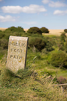 Stone sign marking footpath