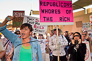 14 OCTOBER 2011 - PHOENIX, AZ:   ROBIN BANKS-DINE´ protests in front of the Bank of America building in Phoenix during the Occupy Phoenix march. About 300 people participated in the Occupy Phoenix march through downtown Phoenix Friday evening, Oct. 14. The march was the first event in the Occupy Phoenix protests which start with the occupation of Cesar Chavez Plaza, a large square in downtown Phoenix.  PHOTO BY JACK KURTZ
