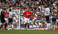 Photo: Leigh Quinnell.<br /> Tottenham Hotspur v Manchester United. The Barclays Premiership. 17/04/2006. Man Utds' Wayne Rooney asks what the free kick was for.
