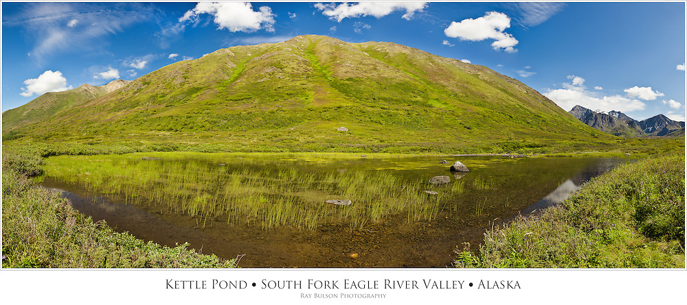 Composite panorama of a pond along the south side of Hurdygurdy Mountain with Cantata Peak and Calliope Mountain on far right in South Fork Eagle River Valley in Chugach State Park in Southcentral Alaska. Summer. Afternoon.