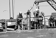 Men working the deck of a freighter as it came through the locks.