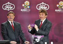 (L) ANDRZEJ SZARMACH AND (R) ZBIGNIEW BONIEK (BOTH POLAND) SHOW THE TICKET OF ENGLAND DURING THE EUFA EURO 2012 QUALIFYING DRAW IN PALACE SCIENCE AND CULTURE IN WARSAW, POLAND..THE 2012 EUROPEAN SOCCER CHAMPIONSHIP WILL BE HOSTED BY POLAND AND UKRAINE...WARSAW, POLAND , FEBRUARY 07, 2010..( PHOTO BY ADAM NURKIEWICZ / MEDIASPORT / SPORTIDA.COM ).