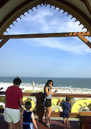 Tourists view the Atlantic Ocean from the observation deck of Lucy the Margate Elephant, Saturday, Aug. 17, 2002, in Margate, New Jersey. Lucy, a sixty-five-foot high, wooden elephant, which was built in 1881, was declared a national historic landmark in 1976. (Photo by William Thomas Cain/photodx.com)