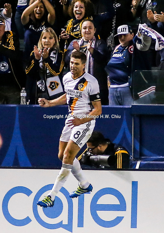 Los Angeles Galaxy midfielder Steven Gerrard celebrates his gaol in the second half of an MLS soccer game in Carson, Calif., Saturday, April 23, 2016. The Galaxy won 5-2. (AP Photo/Ringo H.W. Chiu)