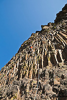 A man climbing a cliff in the Tieton river Canyon, Washington, USA.