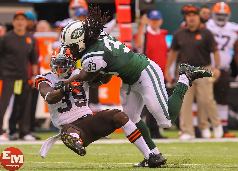 Dec 22, 2013; East Rutherford, NJ, USA; Cleveland Browns free safety Tashaun Gipson (39) tackles New York Jets running back Chris Ivory (33) during the first half at MetLife Stadium.
