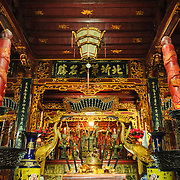 An altar in one of the side chapels at Tran Quoc Pagoda on a small island on West Lake (Ho Tay). Originally built in the 6th century on the banks of the Red River, a changing course of the river forced the pagoda to be relocated in 1615 to Golden Fish (Kim Ngu) islet on the lake.