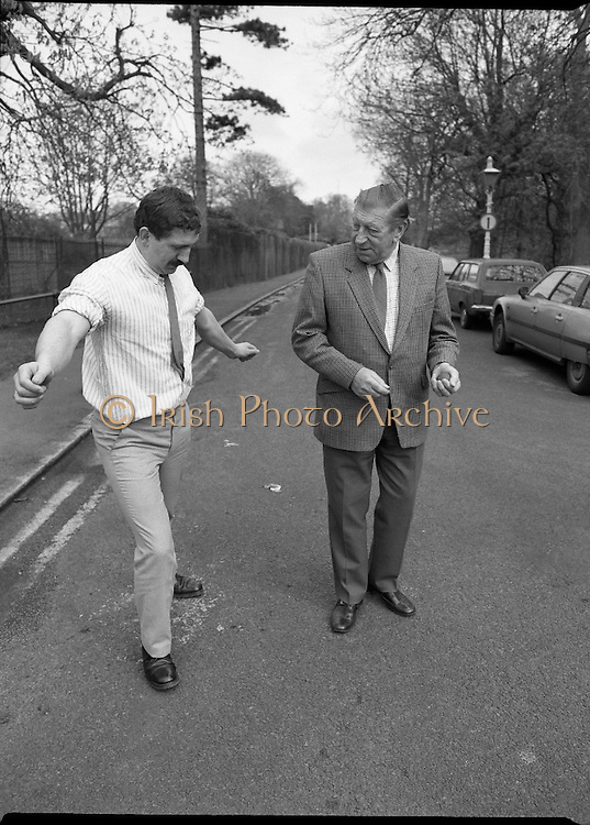 "First Dublin Road Bowling Tournament. (R99)..1989..03.04.1989..04.03.1989..3rd April 1989..The first Dublin road bowling tournament, sponsored by AIB and run by Bol Chumann Na hÉireann, in aid of Cerebral Palsy Ireland. It will take place in the Phoenix Park on Sunday 14th May 1989. This was announced at a reception in the Phoenix Park..The rout of the tournament will be from Mountjoy Crossing through The Whitefields Road to the Phoenix Monument and back the Straight Road to the finishing line at mountjoy Crossing, a distance of two miles..Armagh and Cork will challenge each other for a new Perpetual Trophy ""Super Bol""...Image shows World Champion bowler,Bill Daly, Cork,teaching Mr Norman Cairns, Chairman, Cerebral Palsy Ireland, some of the skills necessary to take part in road bowling."