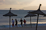 Arenal beach. Joggers, cruise ship leaving Palma harbour.