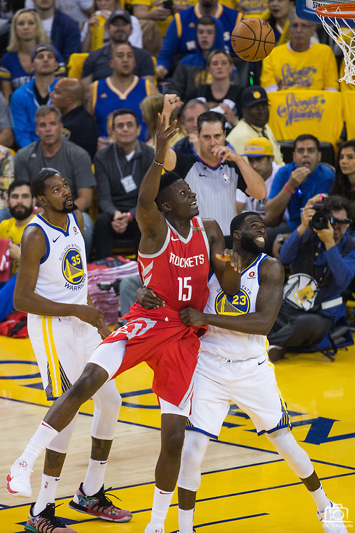 Golden State Warriors forward Draymond Green (23) fouls Houston Rockets center Clint Capela (15) during Game 6 of the Western Conference Finals at Oracle Arena in Oakland, Calif., on May 26, 2018. (Stan Olszewski/Special to S.F. Examiner)