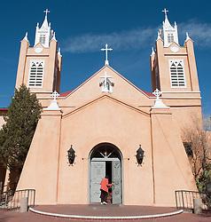 Woman Entering A Church In Santa Fe, New Mexico