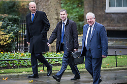 © Licensed to London News Pictures. 14/11/2017. London, UK. From left: Transport Secretary Chris Grayling, Secretary of State for Work and Pensions David Gauke and Chairman of the Conservative Party Patrick McLoughlin arrive on Downing Street for the weekly Cabinet meeting. Photo credit: Rob Pinney/LNP