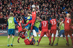 December 9, 2017 - Toronto, Ontario, Canada - Toronto FC defender DREW MOOR (3) heads the ball away from goal over Seattle Sounders defender ROMAN TORRES (29) and Seattle Sounders midfielder CLINT DEMPSEY (2) during the MLS Cup championship match at BMO Field in Toronto, Canada.  Toronto FC defeats Seattle Sounders 2 to 0. (Credit Image: © Mark Smith via ZUMA Wire)