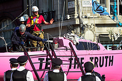 "© Licensed to London News Pictures. 19/04/2019. LONDON, UK. Police officers remove the last activist from the pink boat at Oxford Circus during ""London: International Rebellion"", on day five of a protest organised by Extinction Rebellion.  Protesters are demanding that governments take action against climate change.  Police have issued a section 14 order requiring protesters to convene at Marble Arch only so that the protest can continue.  Photo credit: Stephen Chung/LNP"