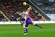 Jayden Stockley (11) of Exeter City battles for possession with Luke Hendrie (27) of Grimsby Town during the EFL Sky Bet League 2 match between Exeter City and Grimsby Town FC at St James' Park, Exeter, England on 29 December 2018.