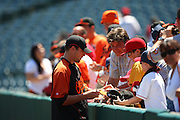 ANAHEIM, CA - JULY 05:  Pitcher Jim Johnson #43 of the Baltimore Orioles signs fan autographs before the game against the Los Angeles Angels of Anaheim at Angel Stadium on Sunday, July 5, 2009 in Anaheim, California.  The Angels defeated the Orioles 9-6.  (Photo by Paul Spinelli/MLB Photos via Getty Images)  *** Local Caption *** Jim Johnson