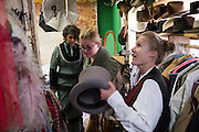 Tourists don thier western outfits before a photo shoot at Professor Shutterbug's Old Tyme Portrait Parlour on Blair Street, Silverton, Colorado.