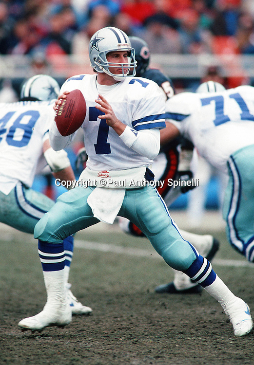 Dallas Cowboys quarterback Steve Beuerlein (7) drops back to pass during the NFL NFC Wild Card playoff football game against the Chicago Bears on Dec. 29, 1991 in Chicago. The Cowboys won the game 17-13. (©Paul Anthony Spinelli)