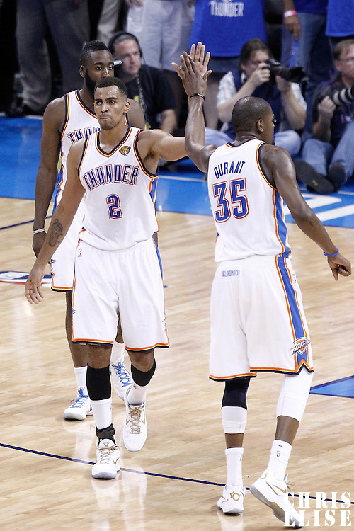 12 June 2012: Oklahoma City Thunder shooting guard Thabo Sefolosha (2) celebrates with Oklahoma City Thunder small forward Kevin Durant (35) during the Oklahoma City Thunder 105-94 victory over the Miami Heat, in Game 1 of the 2012 NBA Finals, at the Chesapeake Energy Arena, Oklahoma City, Oklahoma, USA.