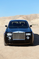 Front view of Rolls Royce parked on unpaved road