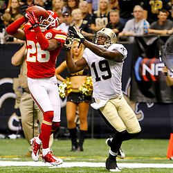 September 23, 2012; New Orleans, LA, USA; Kansas City Chiefs cornerback Stanford Routt (26) intercepts a pass in front of New Orleans Saints wide receiver Devery Henderson (19) during the third quarter of a game at the Mercedes-Benz Superdome. The Chiefs defeated the Saints 27-24 in overtime. Mandatory Credit: Derick E. Hingle-US PRESSWIRE