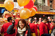 Parade participant holding balloons prior to the start of the parade.