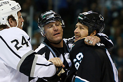 Dec 23, 2011; San Jose, CA, USA; NHL linesman Vaughan Rody (73) separates San Jose Sharks left wing Ryane Clowe (29) and Los Angeles Kings center Colin Fraser (24) during the second period at HP Pavilion. Mandatory Credit: Jason O. Watson-US PRESSWIRE