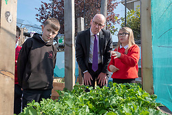 Pictured: Students Kenzie Smith (11) and Alix Kitchin (10) introduced Mr Swinney to the school garden<br /><br />John Swinney headed to Hermitage Park Primary School today to read his favourite bedtime story to pupils to promote the school's 'coorie in' project, an online channel that shares bedtime stories and promotes literacy.<br /><br /> Ger Harley | EEm 14 May 2019