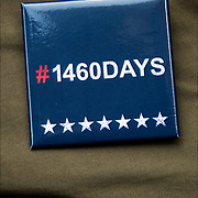 Women March NYC, demonstrator wearing 1460 Days of Action button.<br /> <br /> &ldquo;#DonaldJTrump starting tomorrow you work for ALL of the American people and we will be watching you for #1460days&quot;
